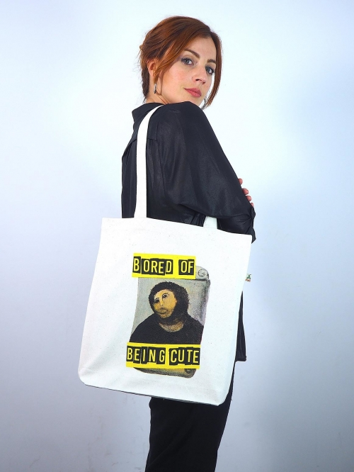 "Tote bag con imagen del ecce homo de Borja con texto ""Bored of being cute"" de Sisteria Shop"